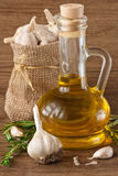 Garlic, olive oil and rosemary. Stock Photo