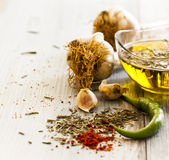 Garlic olive oil and spice close up Stock Photography