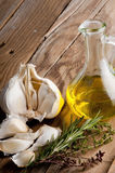Garlic, olive oil , thyme and rosemary Stock Image