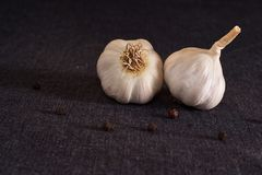 Garlic, onion, bay leaf, black pepper on textile background. Food background. Garlics. sliced garlic, garlic clove, garlic bulb. Garlic, onion, bay leaf, black royalty free stock photo