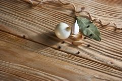 Garlic, onion, bay leaf, black pepper on a wooden table. Food background. Garlics. sliced garlic, garlic clove, garlic bulb. Garlic, onion, bay leaf, black royalty free stock photos