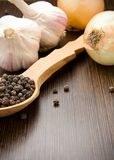 Garlic, onion and black pepper on spoon Stock Images