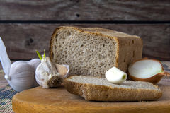 Garlic, onion , bread on the table Royalty Free Stock Image