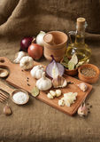 Garlic, onion, coriander, sesame seeds, black pepper, bay leaf, sea salt, olive oil Stock Image