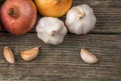 Garlic and onion on an old table, vegetables Stock Photos