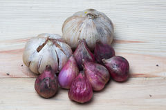 Garlic and onion over wooden background. Stock Photo