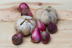 Garlic and onion over wooden background. Royalty Free Stock Image