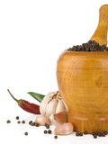Garlic, onion and pepper in mortar and pestle Stock Image