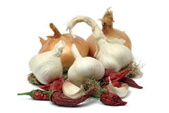 Garlic, onion and peppers Stock Photography