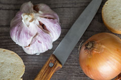 Garlic and onion for the sandwiches /natural healthy concept. Garlic and onion for the sandwiches / natural healthy stock photography