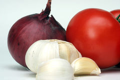 Garlic, onion and tomato Stock Images
