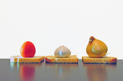 Garlic, onion and tomato on table Royalty Free Stock Images