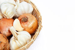 Garlic and onions in a basket Stock Photo