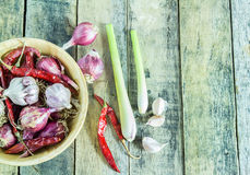 Garlic,onions,dry pepper and lemon grass in wooden bowl on wood Stock Photography