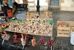 Garlic and onions in an old market Stock Image