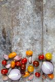 Garlic, onions and tomatoes on rustic boards Stock Images