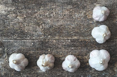 Garlic. Organic garlic whole on the wooden rustic background, top view. Garlic Background. Vegetable Stock Photography
