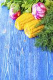 Garlic Parsley dill corn on the table Royalty Free Stock Image