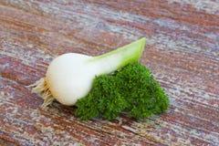 Garlic and parsley Stock Photos