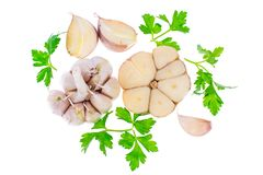 Garlic with parsley and a mix of peppers. Studio Photo Royalty Free Stock Photos