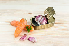 Garlic and parsley in tin can with carrots Stock Photography