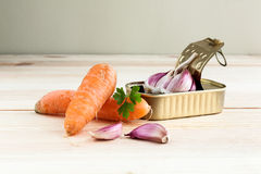 Garlic and parsley in tin can with carrots Royalty Free Stock Photography