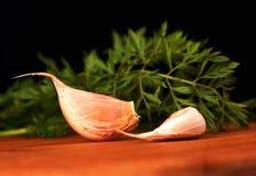 Garlic and parsley Stock Photography