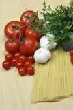 Garlic, pasta and tomatoes Stock Photo