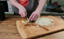 Garlic peeling by hand and knife stock photo