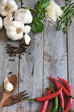 Garlic, pepper, basil, rosemary and parmigiano. Traditional ingredients of italic cuisine - garlic, peppers, basil, rosemary and grained parmigiano. Copyspace Stock Images
