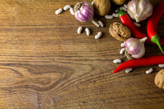 Garlic and pepper on board Stock Photography