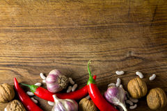 Garlic and pepper on board Royalty Free Stock Photos