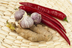 Garlic, pepper and ginger root Stock Photography