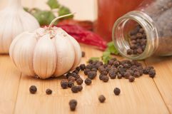 Garlic and pepper with other spices Royalty Free Stock Image