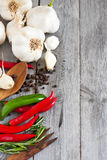 Garlic, pepper, and rosemary side copyspace Royalty Free Stock Image