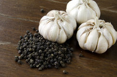 Garlic and Pepper. With a wooden floor backdrop Stock Images