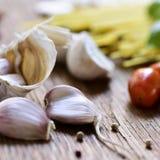 Garlic, peppercorns, cherry tomatoes and spaghetti Stock Image