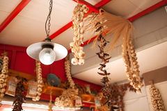 Garlic and Peppers Hanging from Ceiling In Market stock images