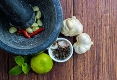 Garlic with Pestle and mortar Stock Images