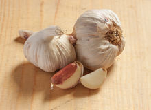 Garlic pieces on the white backgrounds. Garlic slices on the white backgrounds Royalty Free Stock Photo