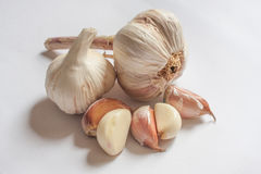 Garlic pieces on the white backgrounds. Garlic slices on the white backgrounds Stock Photo