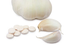 Garlic pills Stock Image