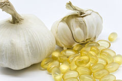 Garlic Pills. Eating alot og garlic isn't always practical or socially desireable. For fear of garlic breath people prefer to buy odorless garlic capsules Stock Photography