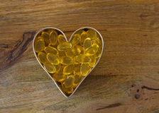 Garlic pills i Stock Images