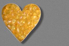 Garlic pills i Stock Photography