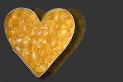 Garlic pills Royalty Free Stock Image