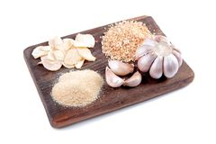 Garlic and pine nuts on a wooden board Royalty Free Stock Photos