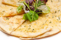 Garlic pita bread pizza with salad on top Stock Images