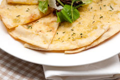 Garlic pita bread pizza with salad on top Stock Photos