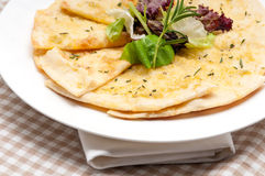 Garlic pita bread pizza with salad on top Royalty Free Stock Images